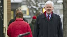 Interim Liberal Leader Bob Rae strolls back to his car after giving a year-end news conference in Toronto on Dec. 30, 2011. (Frank Gunn/Frank Gunn/The Canadian Press)