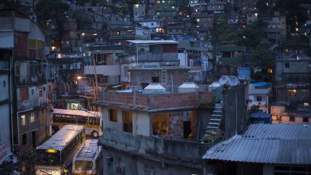 Rocinha's narrow roads becoming congested with bus traffic at rush hour. (Nadia Sussman For The Globe and Mail)