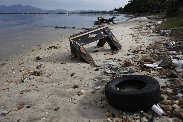 Garbage is seen on Sao Bento beach.