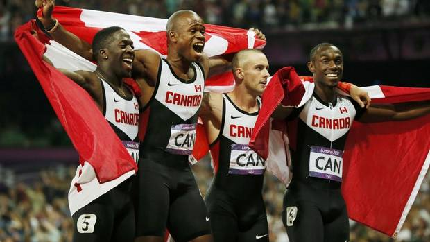 Canada's Justyn Warner, Oluseyi Smith, Jared Connaughton and Gavin Smellie (L-R) pose after the men's 4x100m relay final at the London 2012 Olympic Games at the Olympic Stadium August 11, 2012. Canada finished third but were disqualified. (LUCY NICHOLSON/REUTERS)