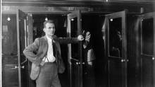 Brokers at a phone booth on opening day of the merged Toronto Stock Exchange and Standard Stock and Mining Exchange. Picture dated 1934. (The Globe and Mail)