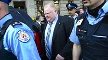 Mayor Rob Ford is escorted to his vehicle by court officers as he leaves the court house in Toronto last week. (Kevin Van Paassen/The Globe and Mail)