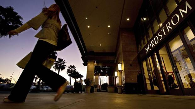 Nordstrom Inc. is an upscale department-store chain based in Seattle, with 231 stores in the United States, including its Rack off-price outlets. Pictured: A customer walks out of Nordstrom in the Canoga Park section of Los Angeles. (The Associated Press)