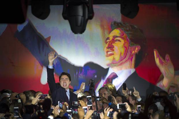Justin Trudeau waves to supporters on election night in Montreal on Oct. 20, 2015.
