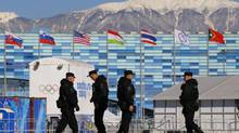 Security personnel patrol the Olympic Park at the 2014 Sochi Winter Olympic Games February 3, 2014. (BRIAN SNYDER/REUTERS)
