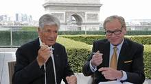 Publicis CEO Maurice Levy, left, and head of Omnicom, John Wren, during a joint signature ceremony for the companies' merger, in Paris on July 28, 2013. (CHRISTIAN HARTMANN)