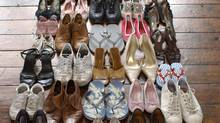 Shoes neatly organised on wooden floor (Martin Poole/Getty Images)