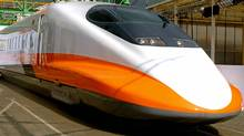 A bullet train for Taiwan High Speed Rail is unveiled at Kawasaki Heavy Industry's Kobe factory in western Japan, 30 January 2004. (JIJI PRESS)