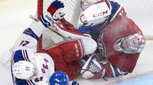 New York Rangers left wing Chris Kreider (20) crashes into Montreal Canadiens goalie Carey Price (31) during second period NHL playoff action in Montreal on Saturday, May 17, 2014. (Ryan Remiorz/THE CANADIAN PRESS)