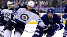 Toronto Maple Leafs defenseman Paul Ranger and Winnipeg Jets defenseman Adam Pardy battle for the puck at the Air Canada Centre. (USA TODAY Sports)