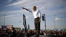 U.S. President Barack Obama points to the crowd during an election campaign rally at McArthur High School in Hollywood, Florida November 4, 2012. (JASON REED/REUTERS)
