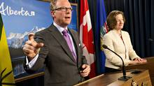 Saskatchewan Premier Brad Wall and Alberta Premier Alison Redford speak to the media on Feb. 27, 2013. Both Premiers are pushing for Keystone approval with American lawmakers and industry leaders. (JASON FRANSON/THE CANADIAN PRESS)