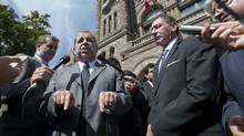 Sam Hammond, speaking, President of the Elementary Teachers' Federation of Ontario, and Ken Coran, right, President of the Ontario Secondary School Teachers' Federation, attend a news conference outside Queen's Park in Toronto on Sept. 11, 2012. (Kevin Van Paass/The Globe and Ma)