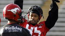Calgary Stampeders' Ken-Yon Rambo, right, getures as he talks with quarterback, Henry Burris, during a team practice in Calgary Friday, Nov. 14, 2008. The Calgary Stampeders face the B.C.Lions on Saturday in the CFL Western Final. (Jeff McIntosh/The Canadian Press)