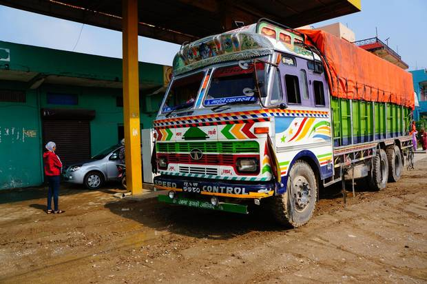 Brilliantly painted Tata trucks drive toward the Indian border empty, and return to Nepal laden with imports.
