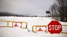 A closed gate at the Babine Forest Products Sawmill in Burns lake December 5, 2012. The Babine Forest Products Sawmill was destroyed by explosion and fire in January that killed two workers and injured 19 others. (John Lehmann/The Globe and Mail)