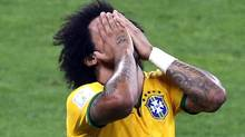 Brazil's Marcelo reacts during their 2014 World Cup semi-finals against Germany at the Mineirao stadium in Belo Horizonte July 8, 2014. (Reuters)