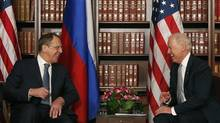 U.S. Vice President Joe Biden, right, laughs as he talks to Sergey Lavrov, Foreign Minister of Russia, during the International Security Conference in Munich on Saturday, Feb. 2, 2013. Mr. Lavrov met with Syrian National Coalition leader Moaz al-Khatib and said he wants to maintain regular contact with the Syrian opposition. (Matthias Schrader/AP)