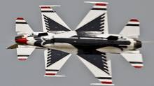 The US Air Force Thunderbirds F16 demonstration squadron performs in Mihail Kogalniceanu, eastern Romania, Wednesday, June 8, 2011. The southern Romanian air base of Deveselu will be one of the stations for AEGIS ballistic missile defense technology, part of the U.S. missile shield in Europe. (Vadim Ghirda/Vadim Ghirda/AP)