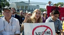 Actress Daryl Hannah protests against a the proposed Keystone XL oil pipeline in front of the White House on Aug. 30, 2011. (SAUL LOEB/AFP/Getty Images)