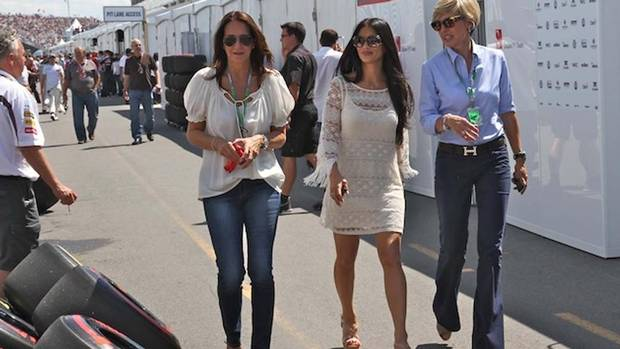 Pop star Nicole Scherzinger (centre) walks along pit lane. Scherzinger, lead singer for a group called the Pussycat Dolls, dates F1 driver Lewis Hamilton, winner of this year's Montreal GP. (Peter Cheney for The Globe and Mail)
