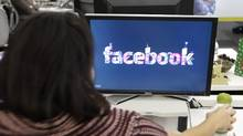 "FILE -This Dec. 13, 2011 file photo, shows workers inside Facebook headquarters in Menlo Park, Calif. Facebook, the social network that changed ""friend"" from a noun to a verb, is expected to file as early as Wednesday to sell stock on the open market. Its debut is likely to be the most talked-about initial public offering since Google in 2004. (AP Photo/Paul Sakuma, File) (Paul Sakuma/AP)"