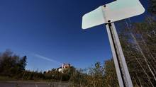 A faded out sign signals the town of Asbestos, Quebec, in front of the Jeffrey mine, September 20, 2012. (Christinne Muschi/The Globe and Mail)
