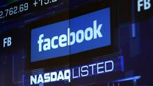 Monitors show the value of the Facebook, Inc. stock during morning trading at the NASDAQ Marketsite in New York in this file photo taken June 4, 2012. (ERIC THAYER/REUTERS)