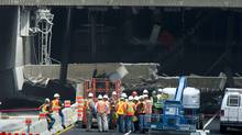 Engineers inspect a concrete slab that fell on a major expressway Monday, August 1, 2011 in Montreal. No one was injured in the collapse on Sunday, the latest in a series of incidents that point to the city's crumbling infrastructure. (Paul Chiasson/The Canadian Press/Paul Chiasson/The Canadian Press)