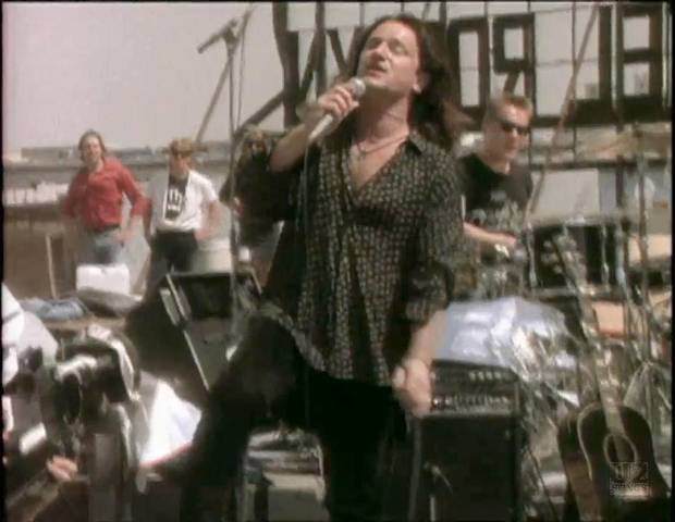 U2 singer Bono performs in the video for Where the Streets Have No Name.