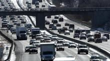 The endless stream of cars and trucks on Canada's highways such as the traffic ( southbound on right and northbound at left) on the Don Valley Parkway in Toronto continues to contribute to Canada's pollution. (Fred Lum/The Globe and Mail)