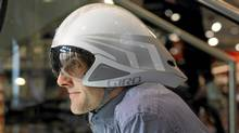 Nick Davie poses with a Giro bike helmet at Sigma Sport store in London, United Kingdom on March 14, 2012. (Jim Ross/The Globe and Mail/Jim Ross/The Globe and Mail)