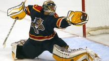 In this file photo Florida Panthers goaltender Roberto Luongo stops a shot in the third period, Nov. 26, 2003 in Sunrise, Fla.