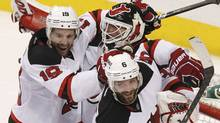 New Jersey Devils goalie Martin Brodeur celebrates with teammates Travis Zajac (19) and Andy Greene (6) after the DEvils defeated the Philadelphia Flyers in Game 5 of their NHL Eastern Conference semi-final playoff hockey series in Philadelphia May 8, 2012. (Reuters)