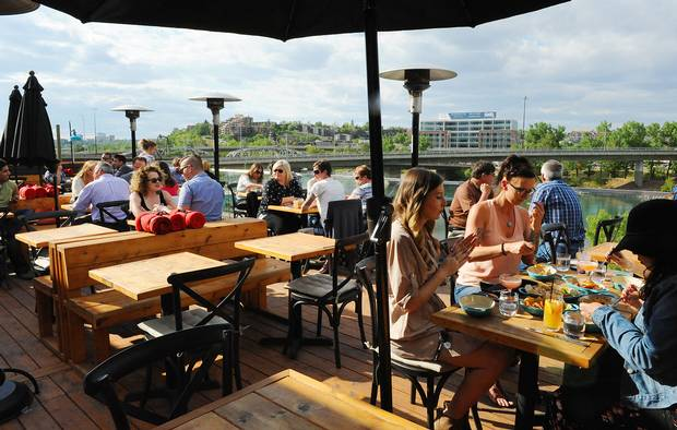 Charbar's patio doesn't need a big fence – it's on the roof, offering a beautiful view of the city skyline.