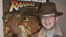 Adventure film buff and software developer Ryan van Barneveld attired in the hat worn by Harrison Ford in the 1984 film Indiana Jones and The Temple of Doom that he acquired at auction for $9,600. (COURTESY OF RYAN VAN BARNEVELD)