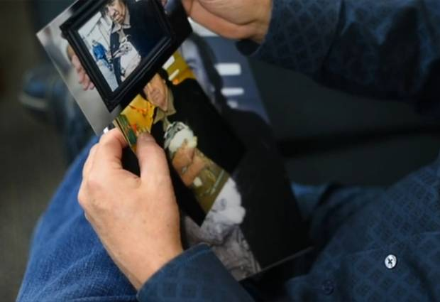 Mr. Yohr browses through photos of his father.