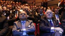 Gustavo Cisneros, left, and former prime minister Brian Mulroney, members of Barrick's board of directors, watch proceedings at the annual meeting, in which shareholders voted against a resolution asking them to approve the way the company pays its executives – push-back after the miner paid co-chairman John Thornton an $11.9-million (U.S.) signing bonus last year. (Fernando Morales/The Globe and Mail)