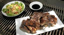 Paired with fresh corn and tomato salad, sticky ribs make for a super-easy yet tantalizing backyard meal. (Fred Lum/The Globe and Mail)