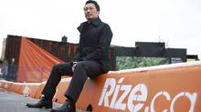 Vancouver developer Will Lin sits on his property at Main Street and Broadway Avenue in Vancouver February 29, 2012 . Lin has plans to develop a 19-storey tower on the property in a neighbourhood of low-rise businesses and homes. (Jeff Vinnick/Jeff Vinnick/The Globe and Mail)