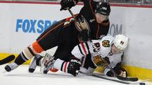 icago Blackhawks right wing Patrick Kane (88) and Anaheim Ducks defenseman Toni Lydman (32) fall to the ice during the first period of an NHL hockey game in Anaheim, Calif., Sunday, Feb. 26, 2012. The Blackhawks are one of several NHL teams to have fallen on hard times writes Eric Duhatschek. (AP Photo/Lori Shepler) (Lori Shepler/AP)