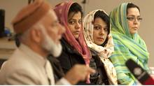 Nurgus Moghal, middle left, Nighat Amir, middle right, and Farina Siddiqui listen to Imam Syed B. Soharwardy in Mississauga on Saturday, as Muslim leaders across Canada and the United States denounced so-called honour killings in the wake of the Shafia murder trial. (Chris Young/The Canadian Press)