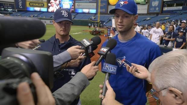 Toronto Blue Jays pitcher J.A. Happ, right, and Tampa Bay Rays pitcher Alex Cobb are confronted by the media on the field before a baseball game in St. Petersburg, Fla., Sunday, Aug. 18, 2013. Both players were injured this season after getting hit in the head by line drives to the mound (PHELAN M. EBENHACK/AP)