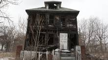 A vacant burned out house sits in an area that used to be filled with houses in Detroit's east end (Deborah Baic/The Globe and Mail)