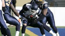 Winnipeg Blue Bombers' Dorian Smith sacks Toronto Argonauts' Cleo Lemon (John Woods/The Canadian Press)