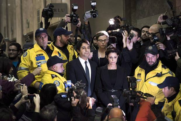 Jian Ghomeshi makes his way through a mob of media with his lawyer Marie Henein at a Toronto court on Nov. 26, 2014. It was the former CBC host's first time in public after being fired by the broadcaster.
