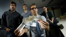 University of Toronto professor Matt Ratto, left, used a 3-D printer to build a plastic handgun with his team: postdoctoral researcher Isaac Record and PhD students Dan Southwick and Ginger Coons. (PETER POWER/THE GLOBE AND MAIL)