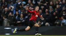 Manchester United's Robin Van Persie celebrates his goal against Manchester City during their English Premier League soccer match at The Etihad Stadium in Manchester, England, Dec. 9, 2012. United claims to be the world's best-supported soccer team, with more than 650 million followers worldwide and regular 75,000-strong capacity crowds at their Old Trafford stadium. (EDDIE KEOGH/REUTERS)
