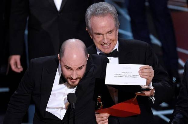 Jordan Horowitz, producer of La La Land, shows the envelope revealing Moonlight as the true winner of best picture at the Oscars on Feb. 26, 2017, at the Dolby Theatre in Los Angeles.