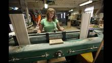 BG Furniture employee Kim Craig prepares pieces of wood for drawers at the company's Walkerton factory. (Deborah Baic/Deborah Baic/The Globe and Mail)
